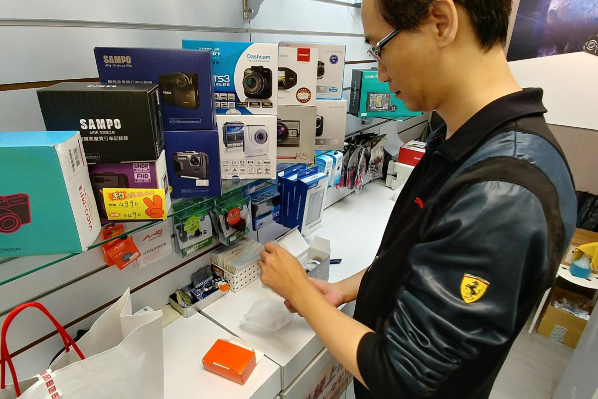 Shopkeeper works on a product