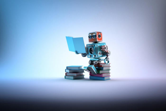 artificial intelligence / machine learning / robot reading stack of books
