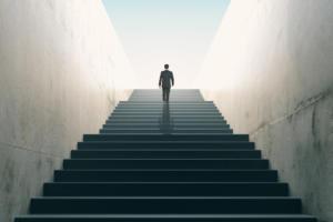 businessman climbing stairs / growth / achievement / new territory