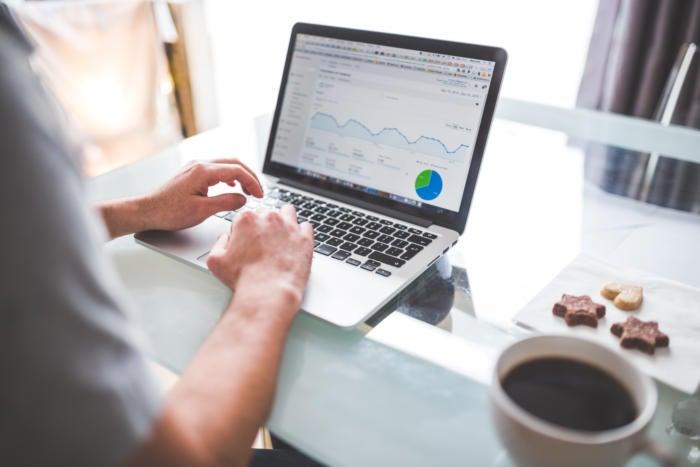 Data analytics charts on a MacBook Pro laptop