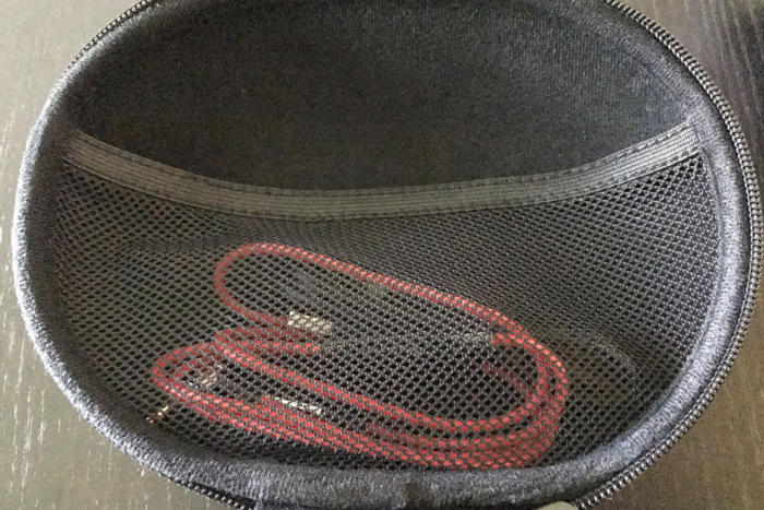 The Phiaton BT 460's carrying case has a mesh pouch in the upper lid.
