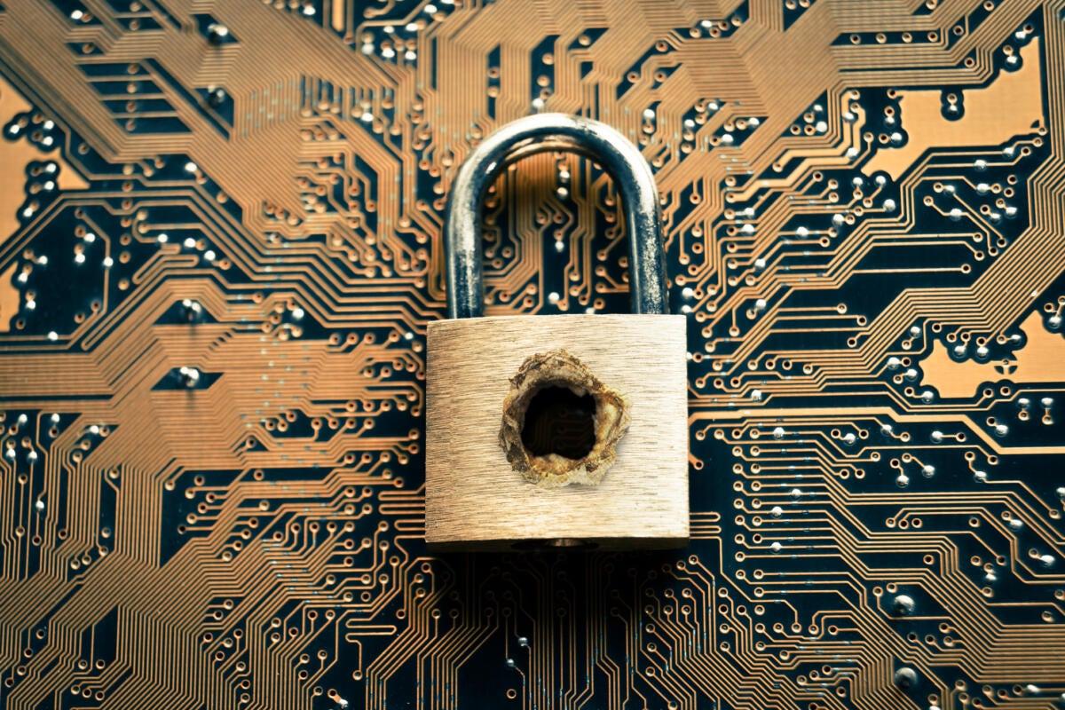 hacking cybersecurity padlock motherboard