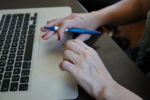 womans hands on touchpad