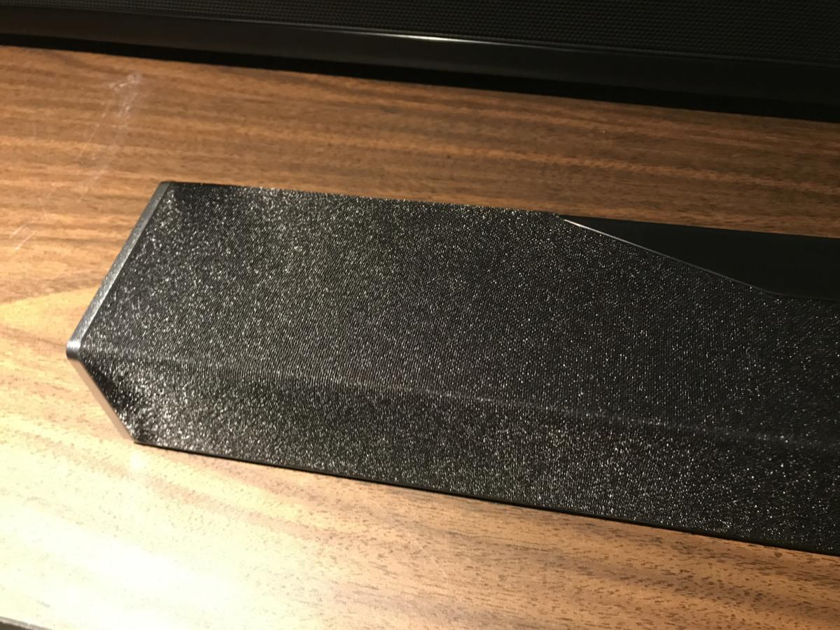 Unlike most sound bars, the Onkyo has a cloth covering on top of thespeaker to hide the two upfiring