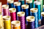 thread weave spools diverse colorful sew2