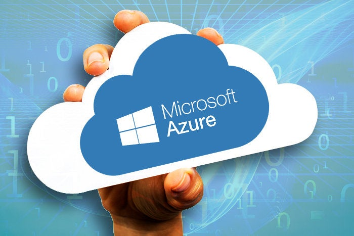 hand holding paper cloud for Microsoft Azure logo