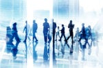 abstract image of business silhouettes in blurred motion