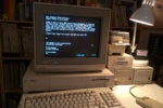amiga 1000 connected to an apple iigs hosted bbs via telnet9