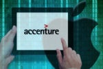 hand holding iPad with apple and accenture logos