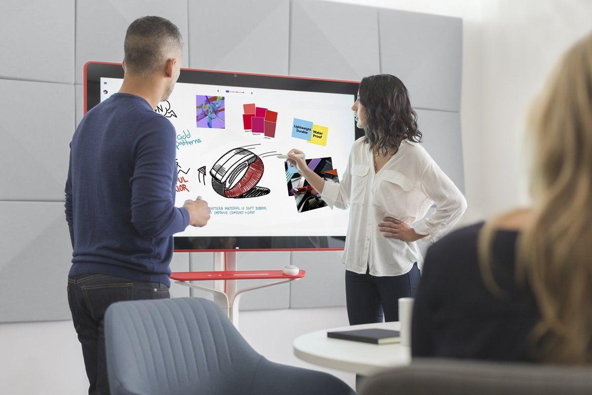 people using Google Jamboard interactive display