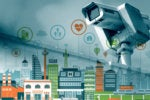 Internet of Things security camera looming over city