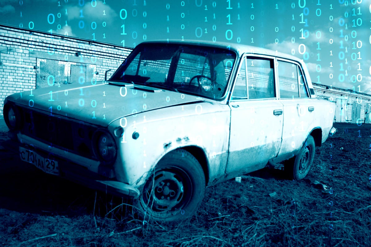 old car in need of repair with binary numbers in background