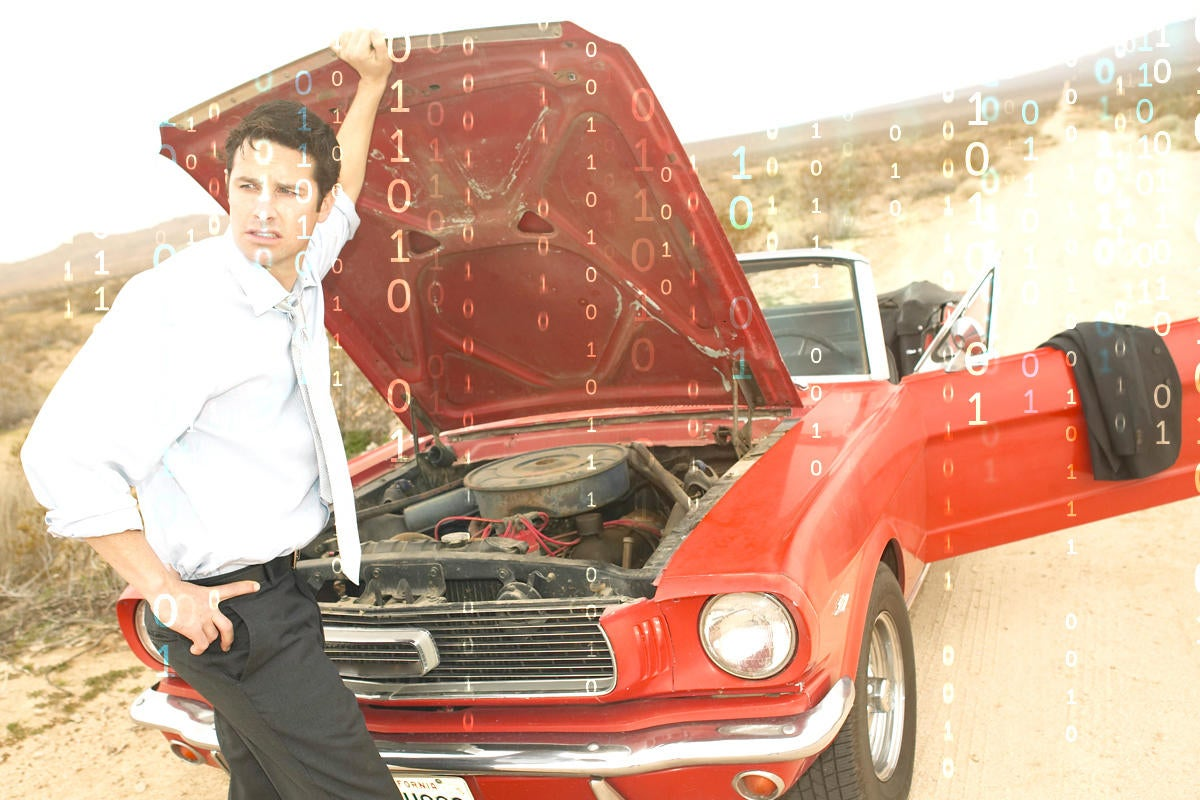 Broken down red mustang with man holding up car hood