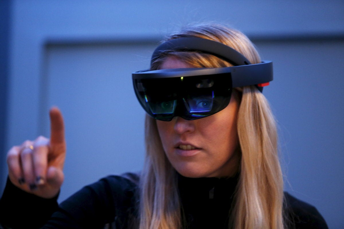 Microsoft hololens virtual reality glasses worn by woman