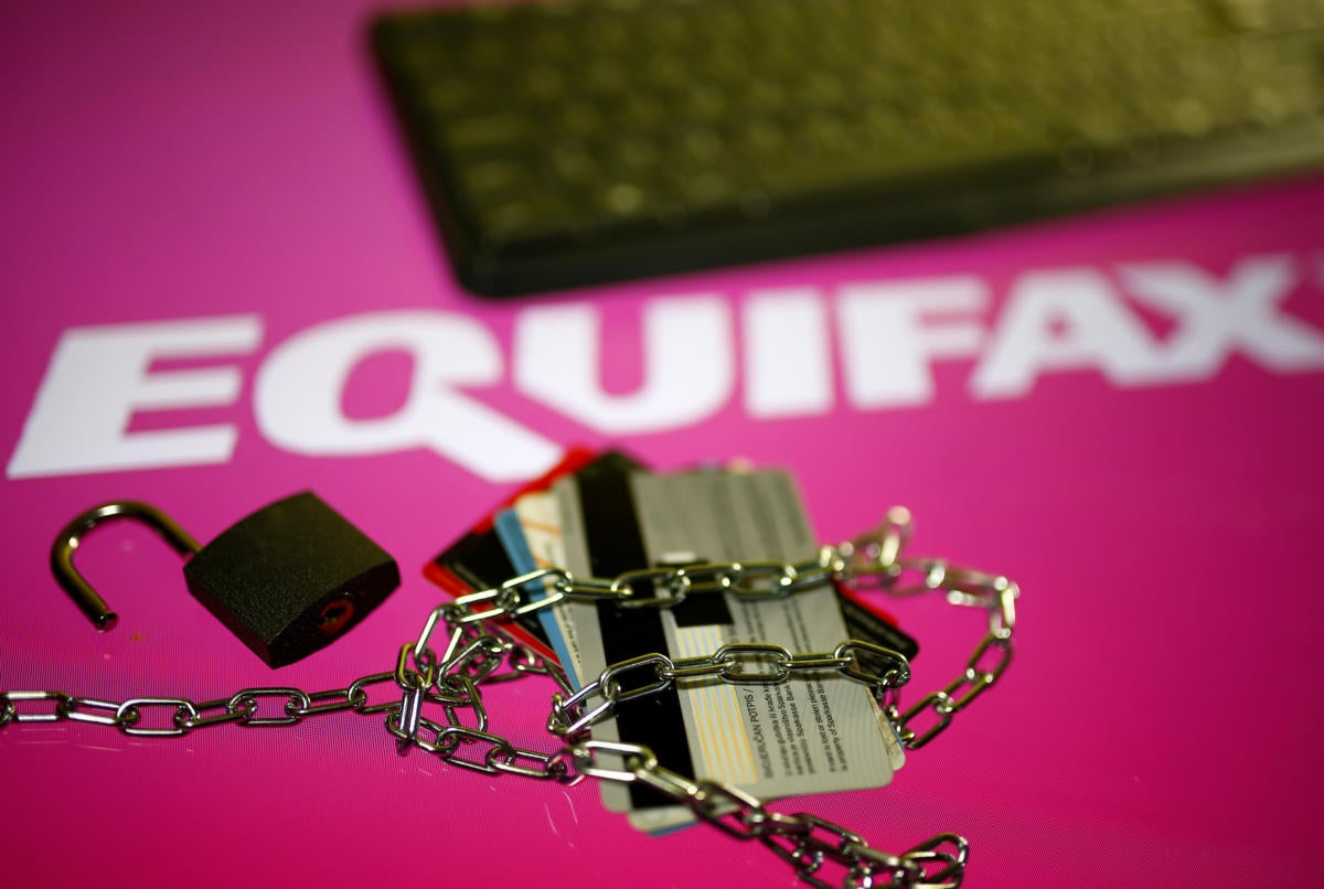 Equifax logo with keyboard lock and credit cards