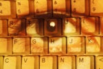 face superimposed on keyboard privacy hacker