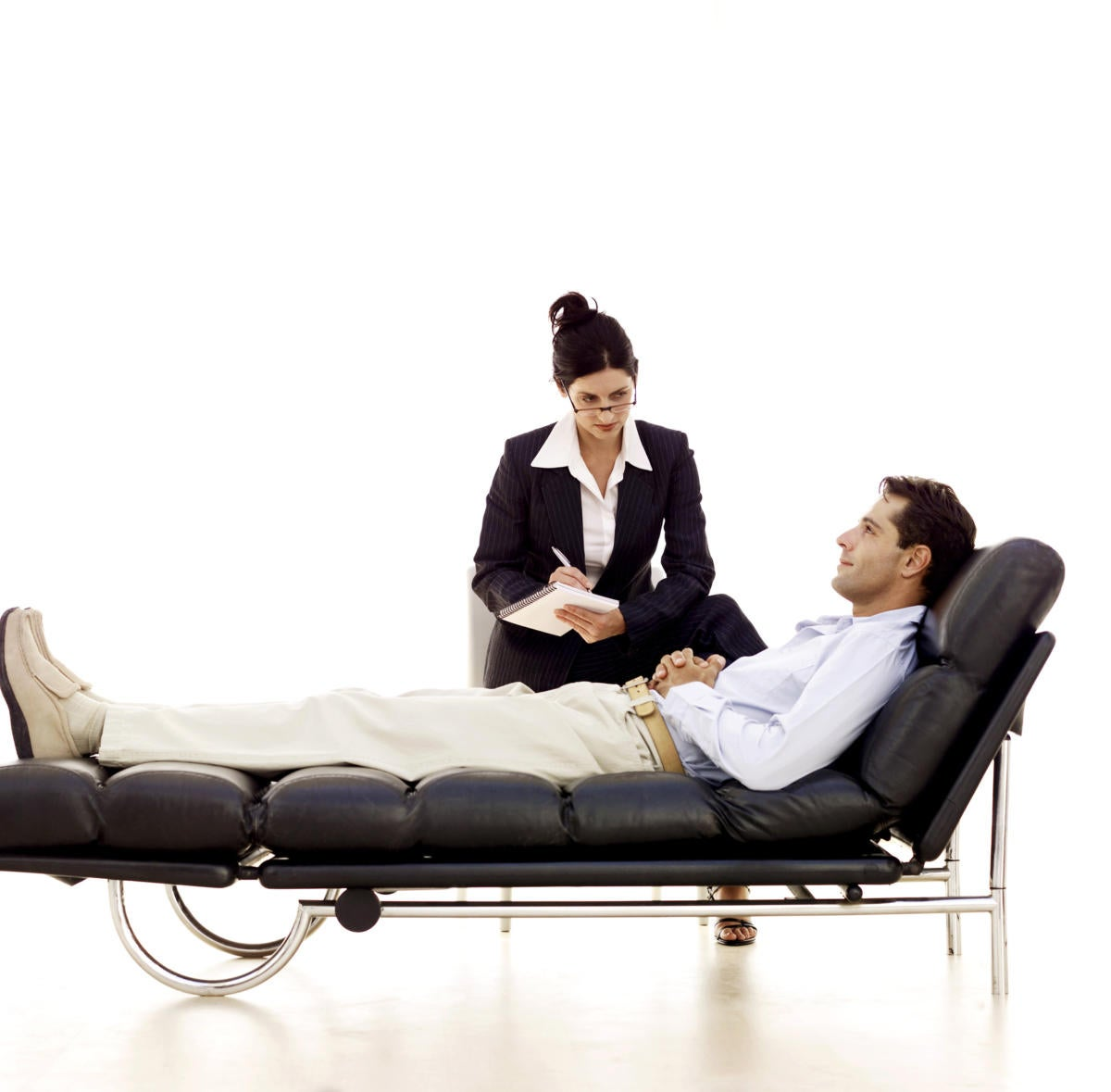 Man laying on psychiatrists couch getting therapy