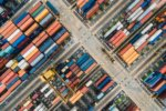 aerial view of shipping containers [by StockSnap - CC0 via Pixabay]