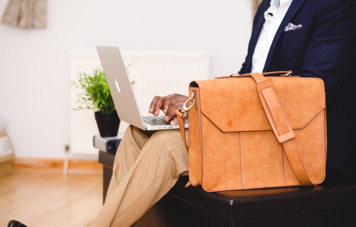 man laptop briefcase working job hunting diversity [by Olu Eletu - CC0 via Unsplash]