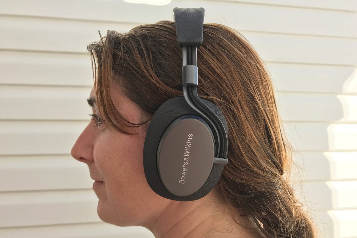 Woman wearing B&W PX headphones