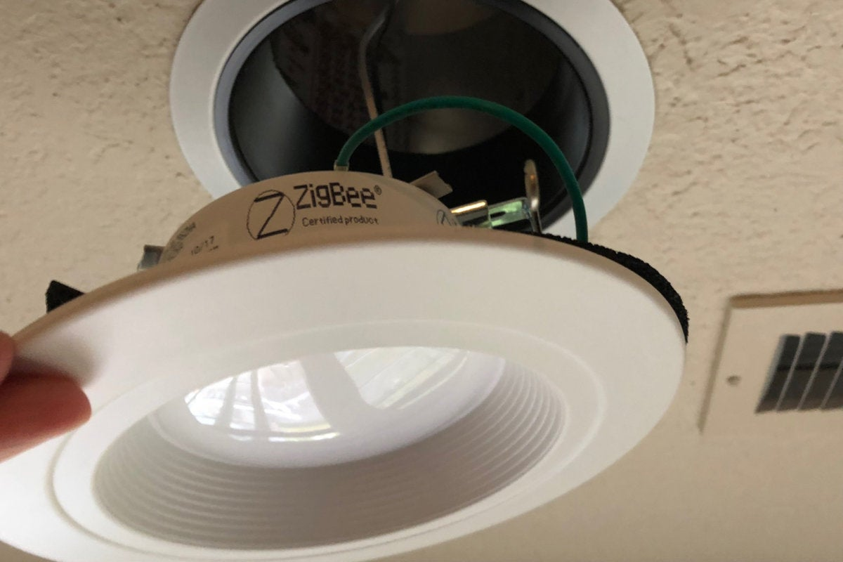 Halo ZigBee recessed downlight being installed