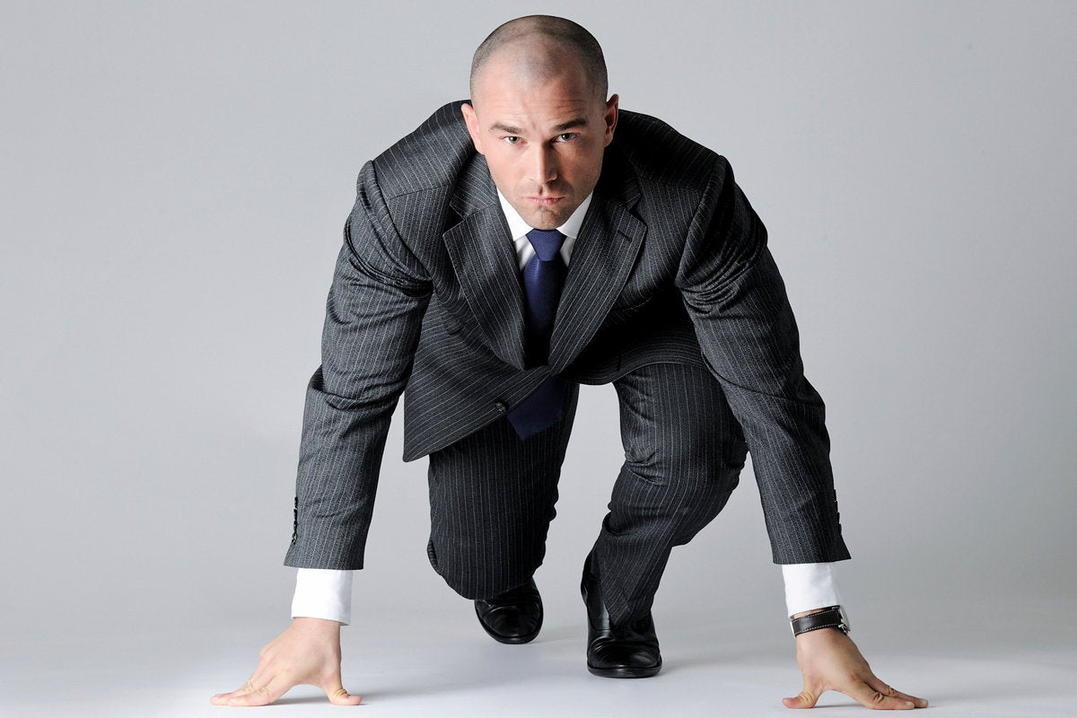 businessman at starting line race speed compete