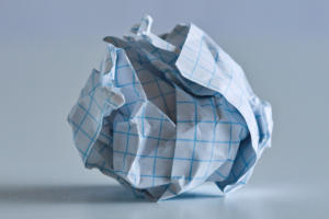 crumpled graph paper cold trend chart failure