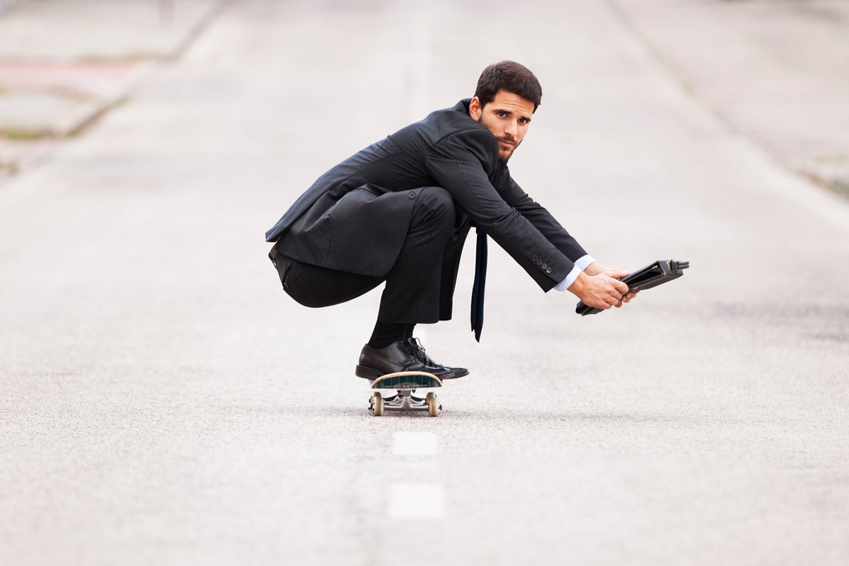 flexible skateboarder agile businessman