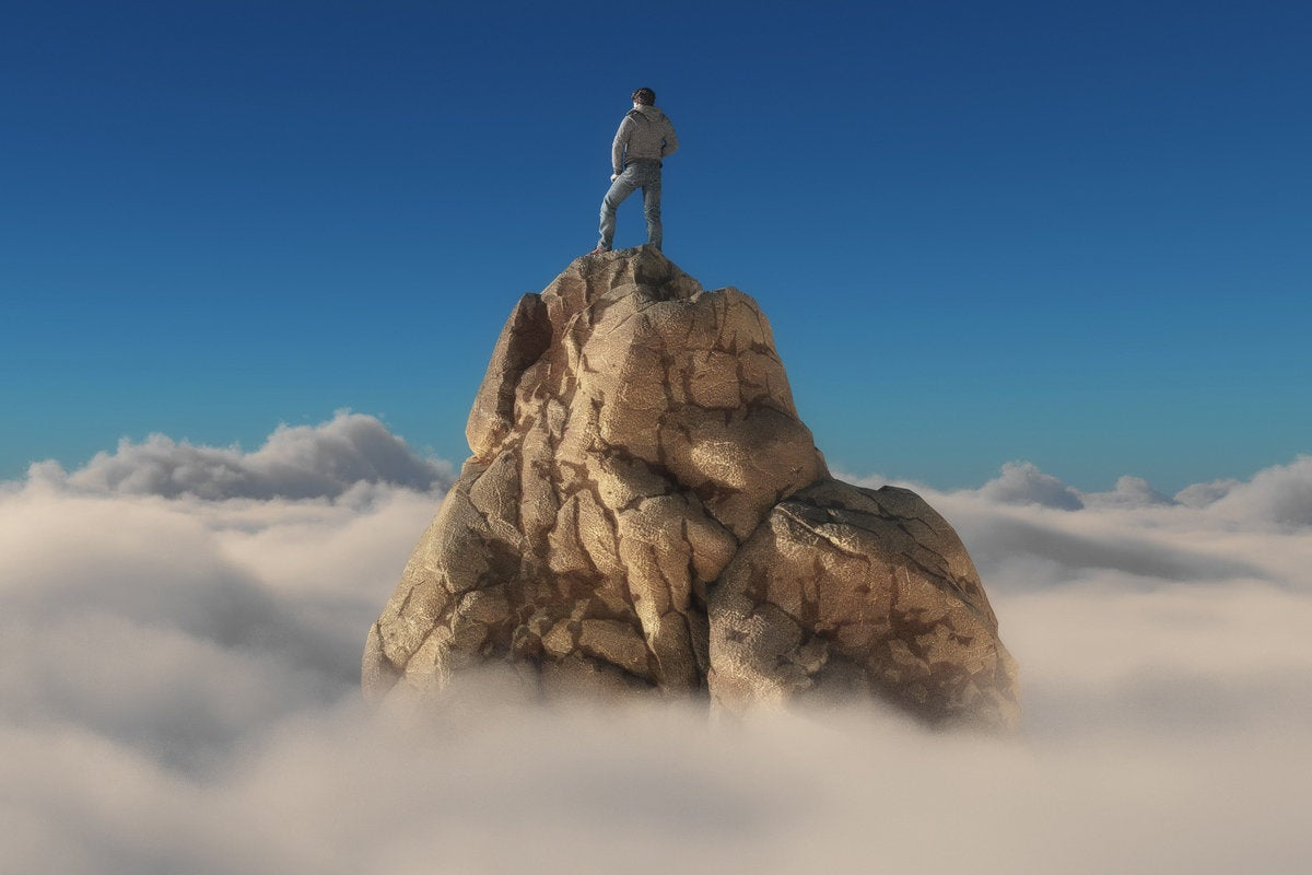 man on mountain top winner leader alone
