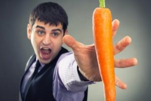 man reach for carrot salary benefits perks temptation