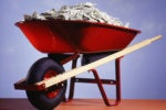 red wheel barrow pile of money high paying salary