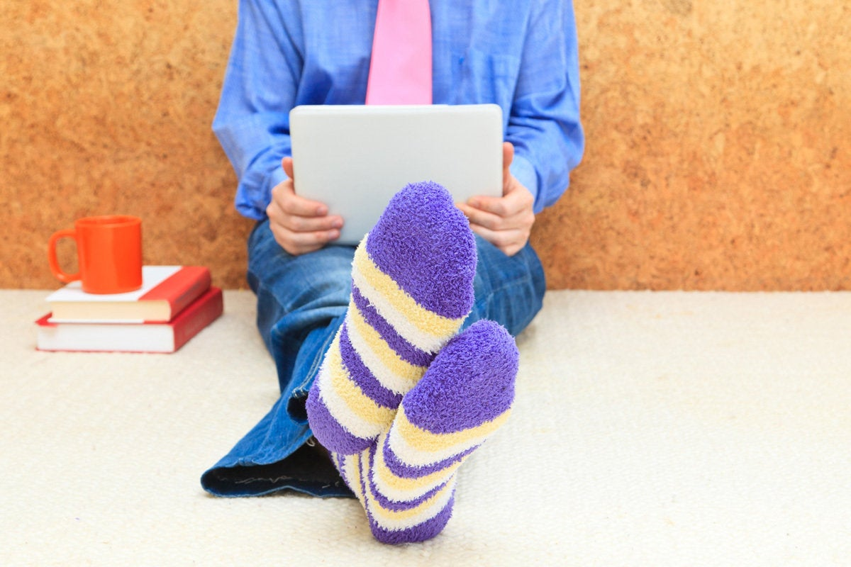 remote worker student working from home striped socks laptop