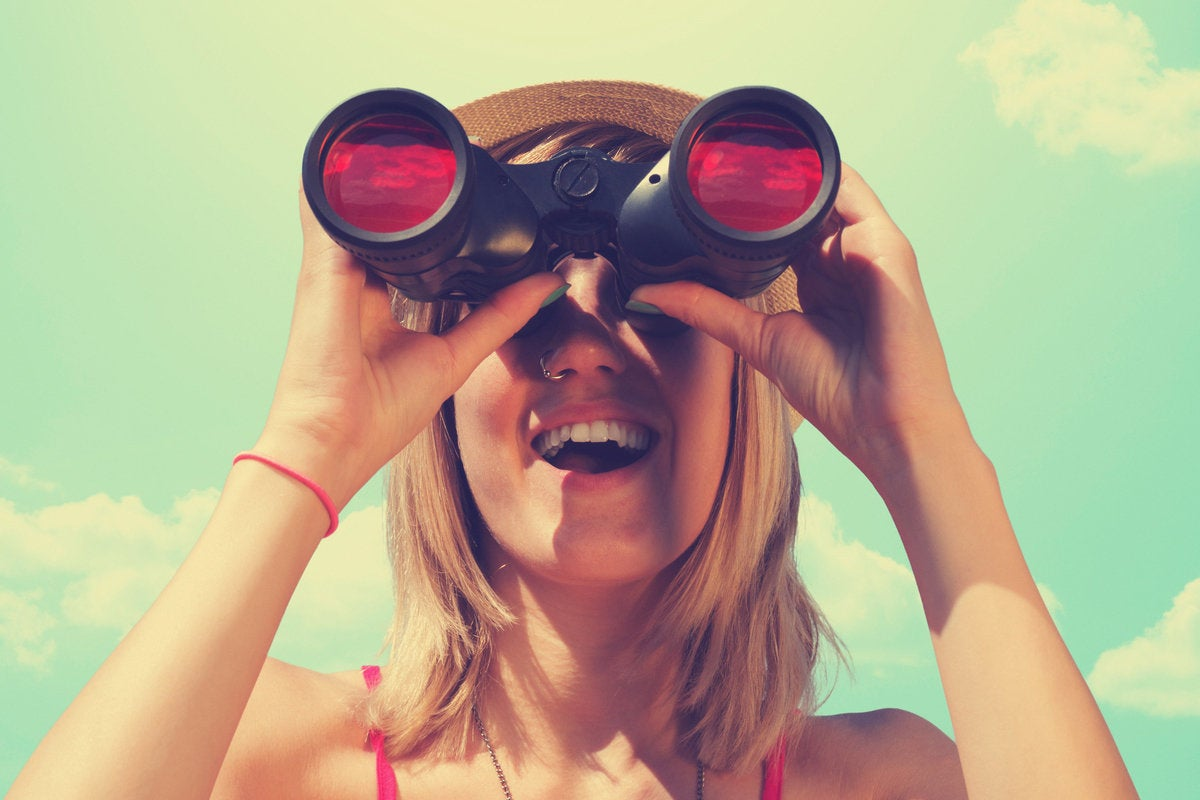 women looking through binoculars future vision prediction millennial