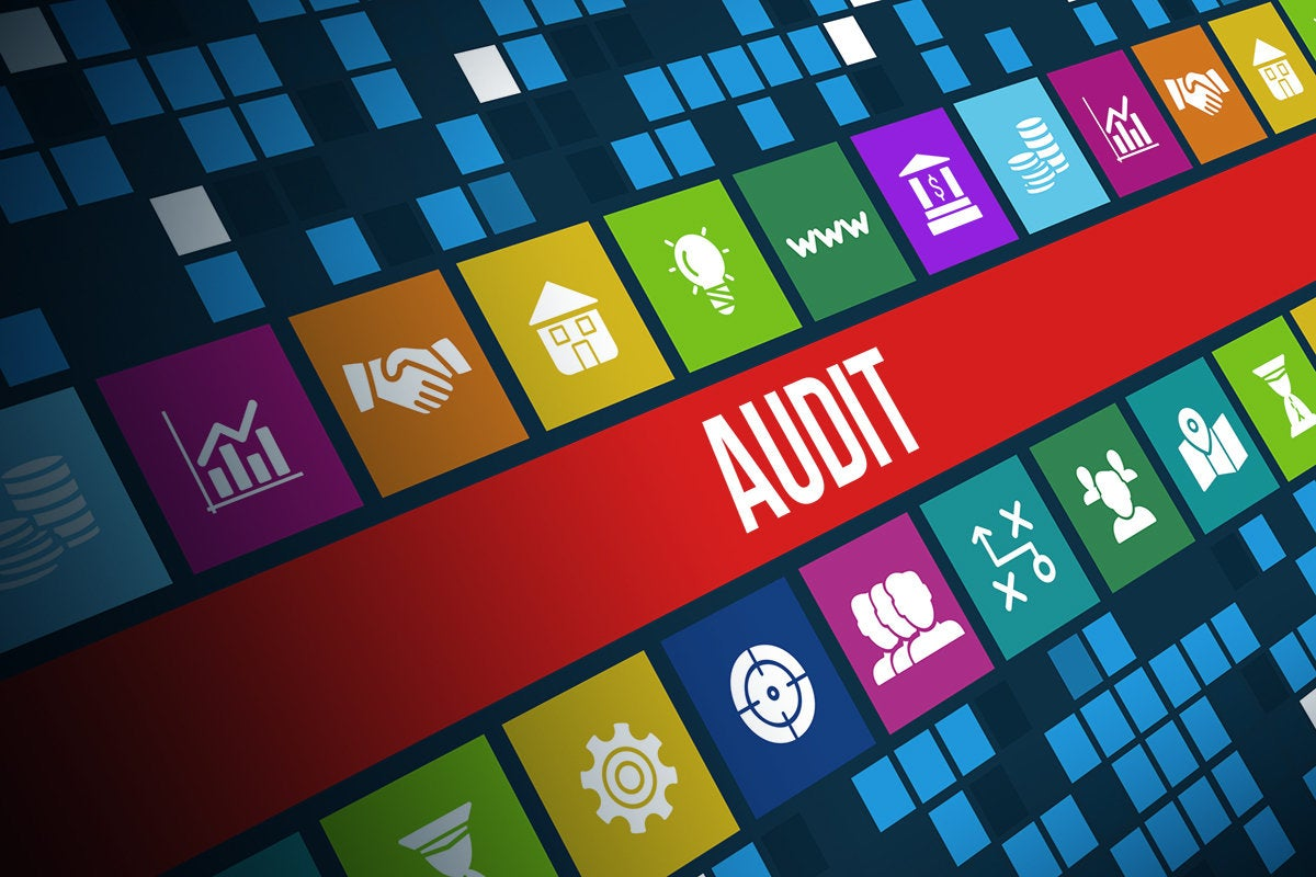 audit alert amid FinTech symbols