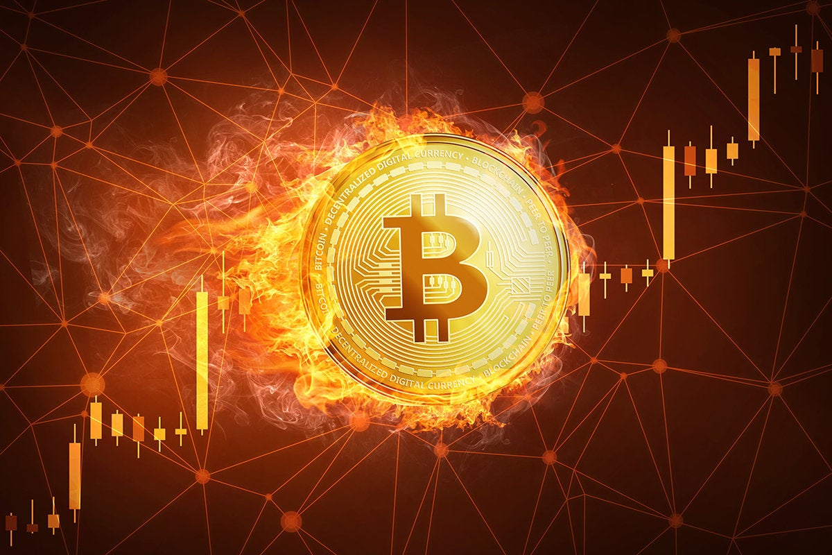bitcoin increasing in growth with a fiery background