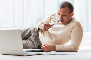 Guy looking at laptop