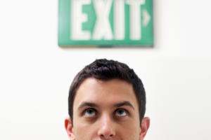 man looking at exit quit termination