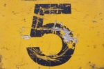 number 5 on yellow grunge background top five