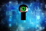 privacy breach - surveilling eye at a digital keyhole in a binary wall