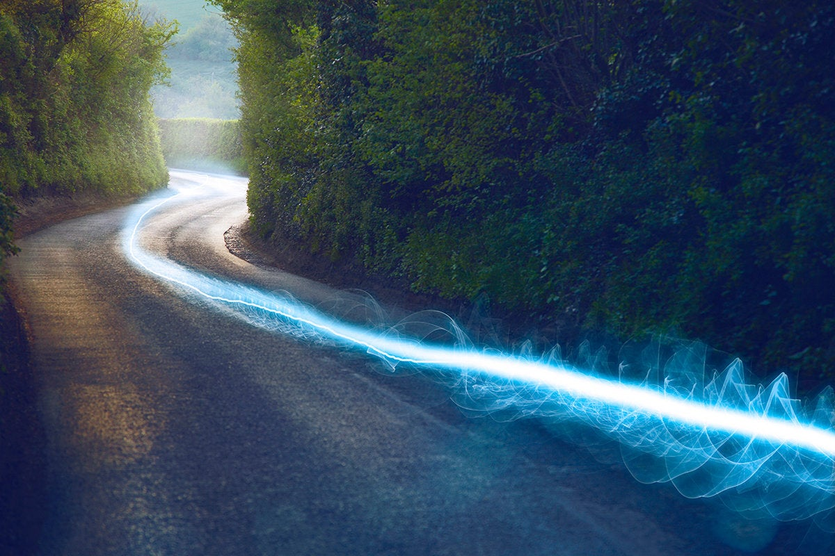blazing speed leaving a glowing trail along a road