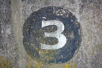 number three painted on concrete