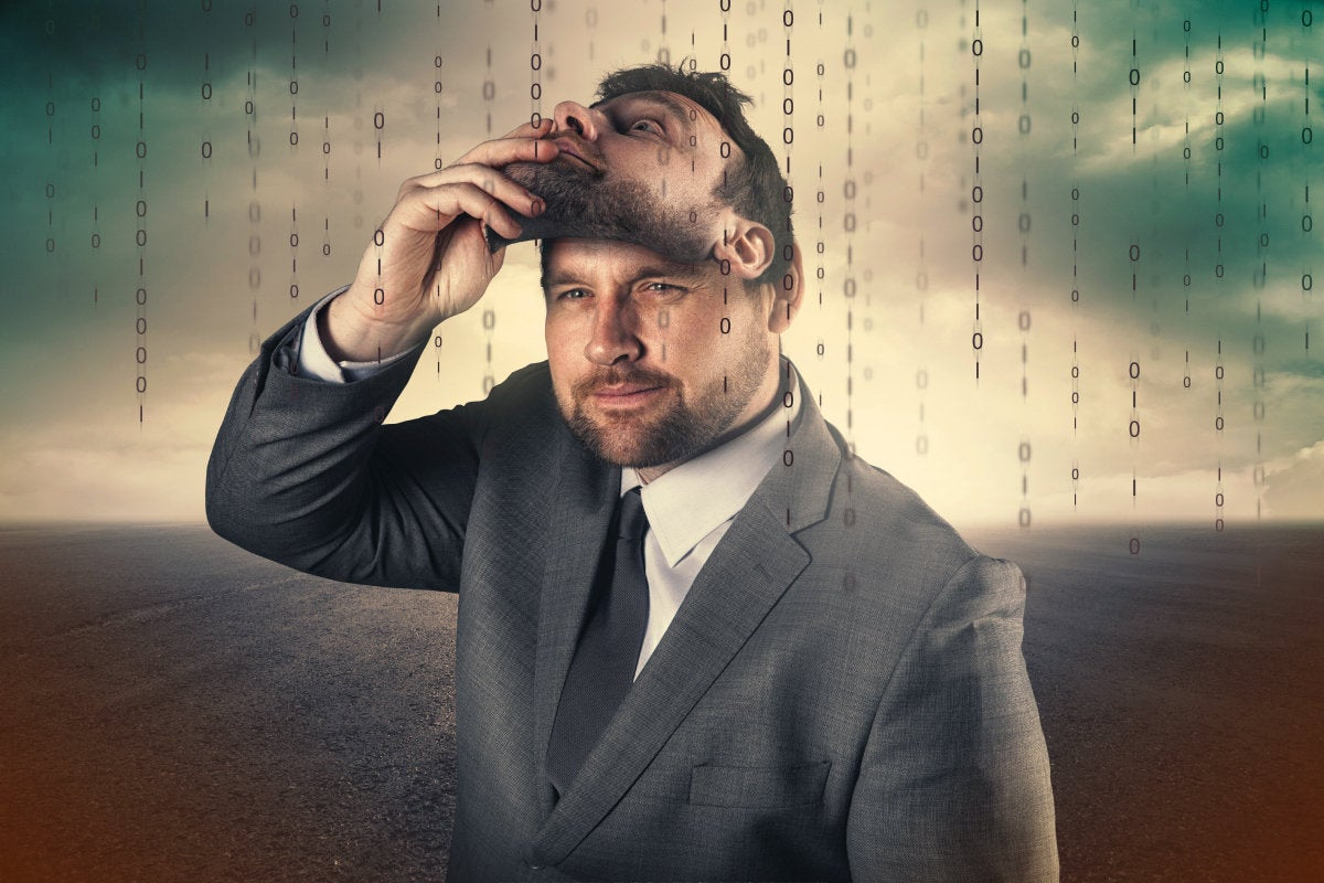 CSO slideshow - Insider Security Breaches - Two-faced businessman removes his mask in a binary world