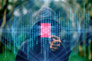 a hooded figure targets a coding vulnerability