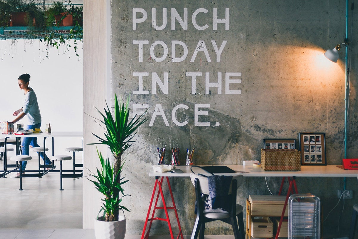 Sign in a co-working workspace: Punch today in the face