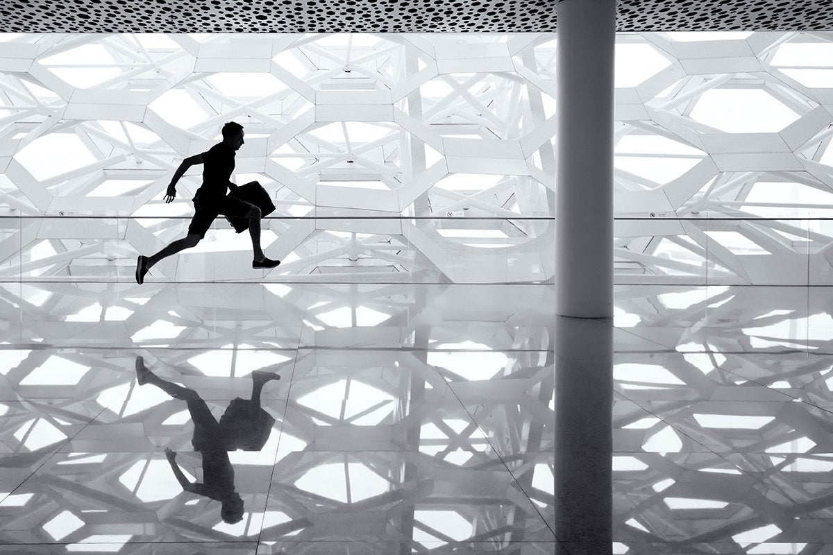 a man runs through an abstract background