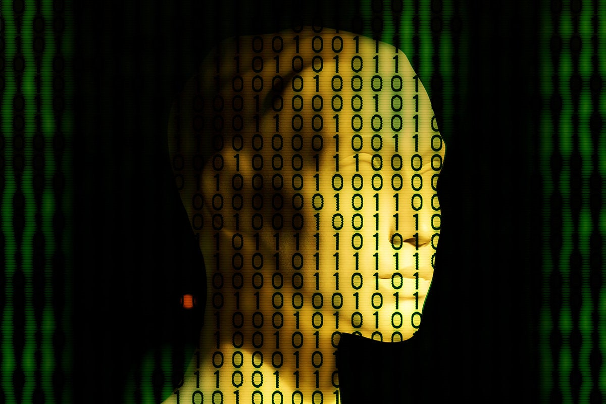 binary code displayed across an artificial face