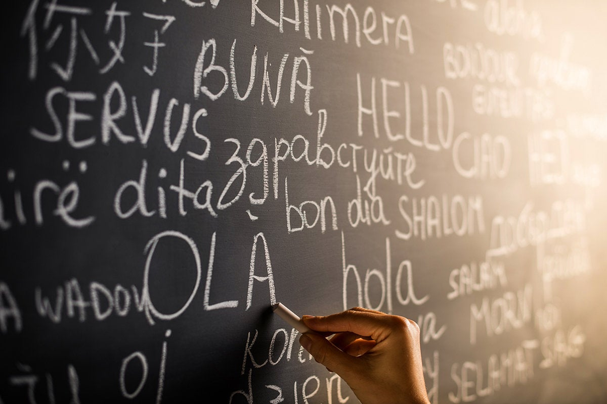 'Hello' written in many languages on chalkboard.