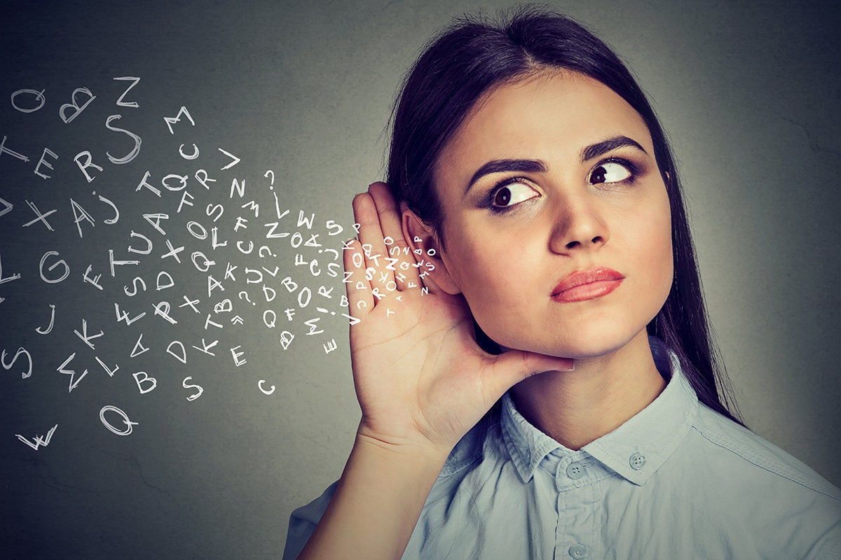 Conceptual images of a woman listening to a stream of abstract letters.