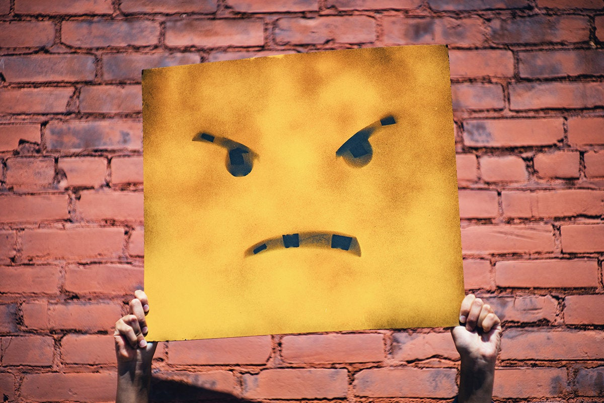 sad angry unhappy frustrated hands holding sign andre hunter 350301 unsplash