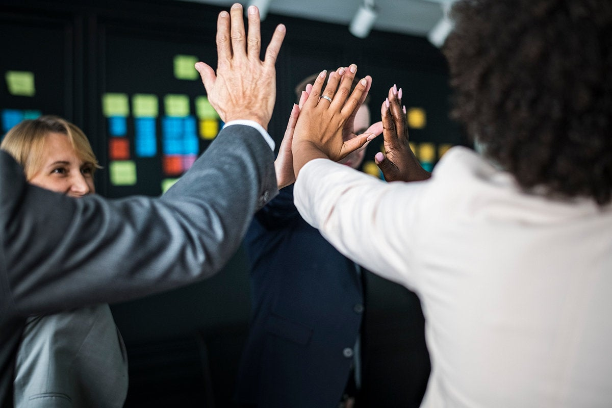 high five among a happy, collaborative group
